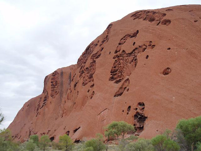 The face of Uluru eroded by the weather